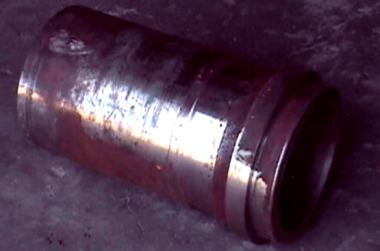 Heavy wear on a mud pump component.